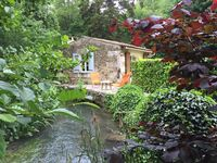 Mill cottage in lush valley