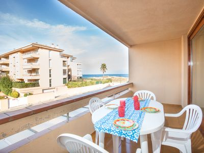 Photo for Spacious and bright apartment on the beach, free wifi, pool, garage, Golf.