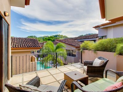 Photo for Sunny condo with shared infinity pool & tennis courts - steps from the beach