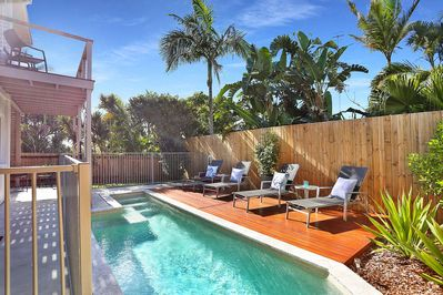 Private pool area overlooking grass section
