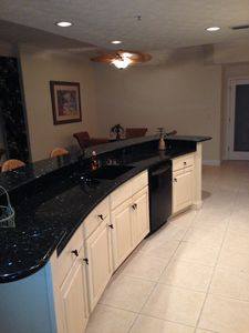 Custom cabinets accent the beautiful granite counters