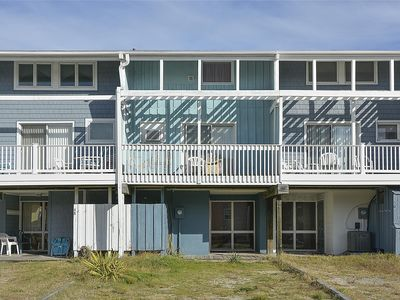 """Photo for FREE DAILY ACTIVITIES! Located approx one half block from the beach, this """"vintage""""  multi-level  basic beach townhouse includes 4 bedrooms, 2.5 baths, 4 window air-conditioners in bedrooms"""