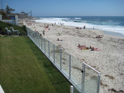 View of beach to the south from main deck (lawn is not part of property).