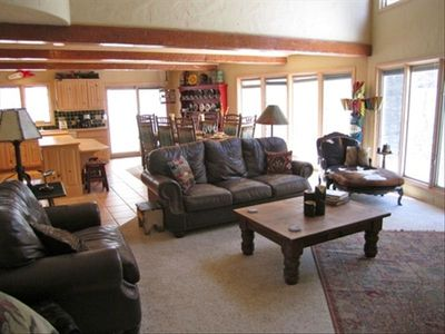 Huge living room. Windows along the entire back of house looking out to river.
