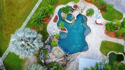 Step into southern living with a resort style pool with a lazy river and grotto!