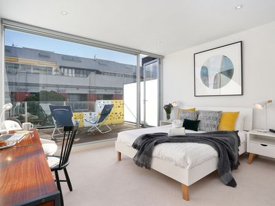 Photo for Light, airey 2 storey 2 deck penthouse in Collingwood nr cafes restaurants trams