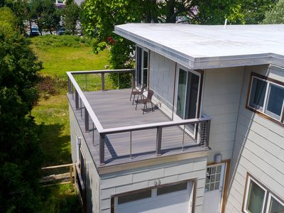 Photo for Modern beach home w/ deck, central AC, & free WiFi, steps from the ocean
