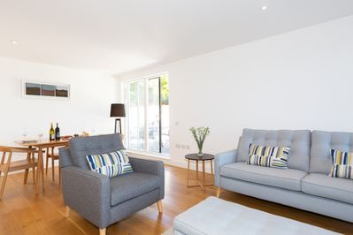 Living/dining area has access to private sun terrace
