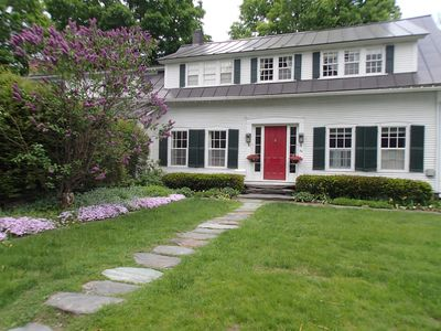 Here is the front of the house in the spring. We love to garden!