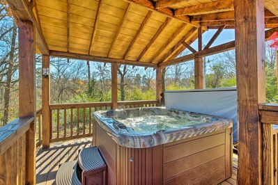 Find your 'Rain Tree Retreat' at this Broken Bow vacation rental cabin.