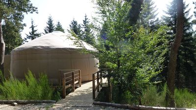 Photo for 1 comfortable contemporary yurt located in a wood terrace with views.