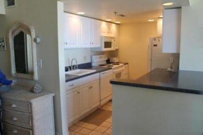 Open kitchen with counter bar area.  Opens to dining and family rooms.