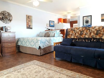 A queen sized bed and a queen sized futon provide sleeping for four people.