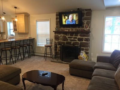 Large Family room with fire place and sofa sleeper