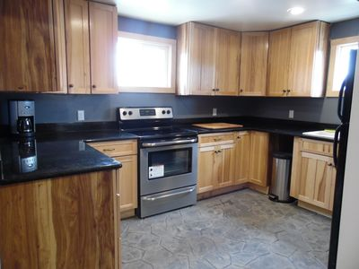 Brand New Kitchen with new appliances, granite counters, fully stocked.