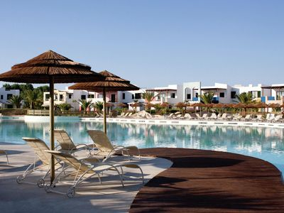 Photo for Comfortable apartment in luxury resort with open air swimming pool, 3.5 km from the sea