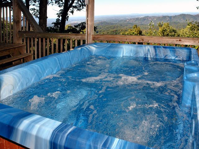 Walk in the clouds in this 4BR/3BA log home perched above the clouds overlooking P F, Sevierville.