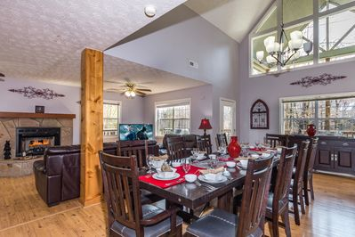 Open dining area to kitchen and living room. Large 12 person dining table.