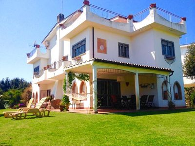 Photo for Beautiful Villa in Fregene facing the sea with large garden and bbq