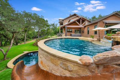 Back Pool Slide  - Slide into fun and adventure with family and friends in this multi-level pool
