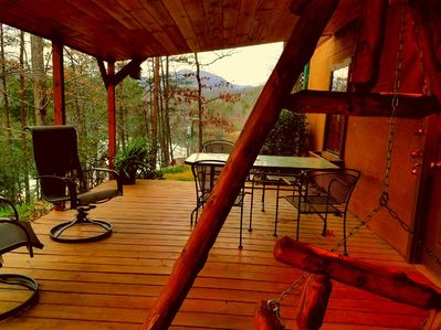 lower deck-huge mountain,lake views- with sounds of the river.Grill and seating