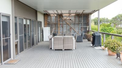 large undercover outdoor area with weber BBQ and large table