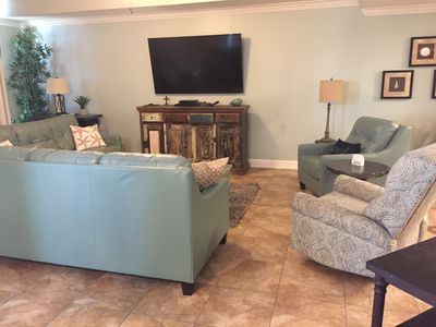 Spacious Living Room with 70 inch Smart TV and DVD