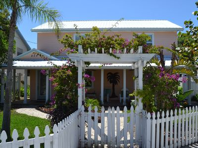 Photo for Lovely two story home just steps from the beach!