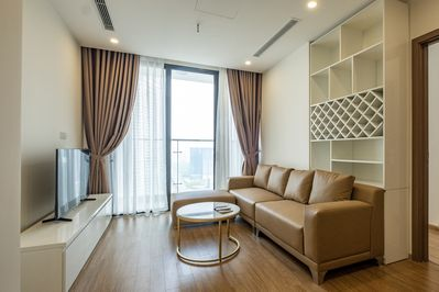 Livingroom with leather sofa/ internet tv/ skyview and a big logia