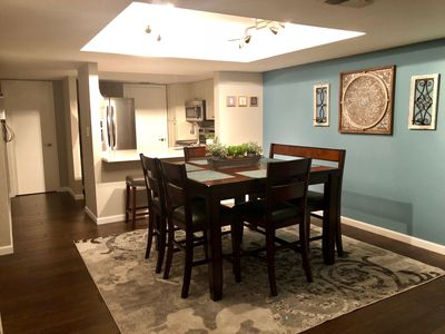 Open floor plan. Dining room seats 6 at table and 2 at counter bar stools.