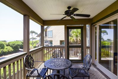 Screened porch off of living room with stairs leading to the beach boardwalk