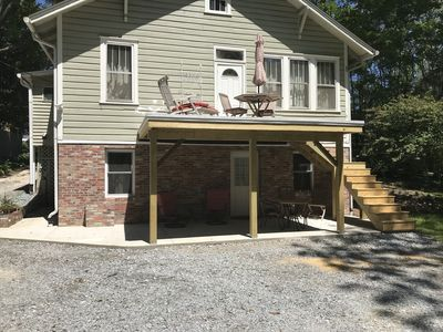 Off street parking, apartment entrance and private deck with charcoal grill