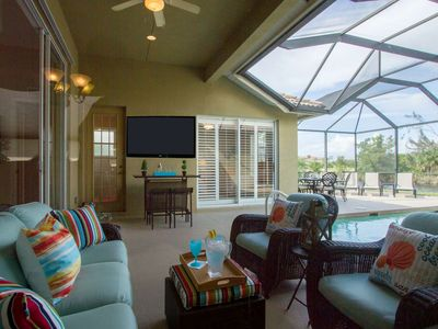 Photo for Fabulous upscale Briarwood lake view pool home w/outdoor TV, bar, dining, & entertaining area!
