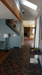 Entering the house from the front door.  Family room fireplace can be seen