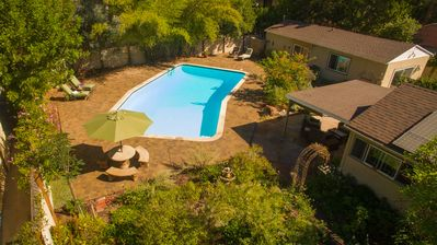 Photo for Private Garden Home with Large Saltwater Pool,  Serene Office, Fireplace etc.