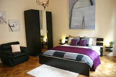 Spacious tranquil bedroom with a king size bed