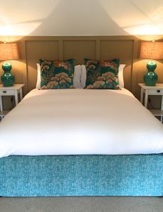 Boutique style King Size bed with designer fabrics and crisp white sheets.