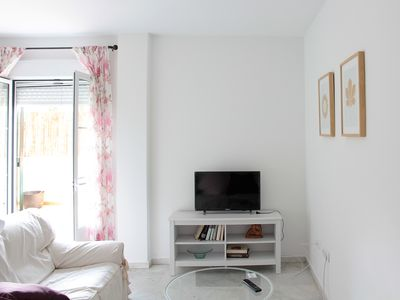 Photo for Bright and cozy, central area garage, terrace, wifi, A / C