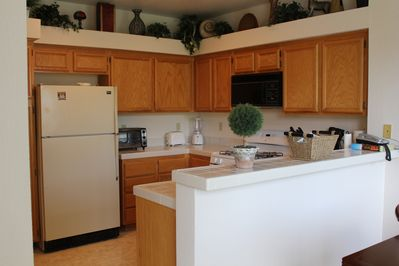 Fully loaded kitchen with full amenities (dishwasher, fridge, dishes, cups, etc)