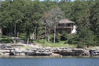True Lake front with amazing setting and cliffs in your own backyard