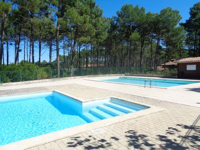 Photo for Lacanau house under the pines with swimming pool
