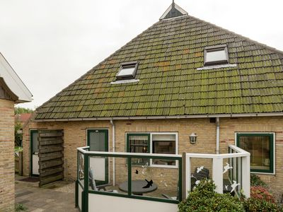 Photo for Cosy holiday home for two people with terrace in the Terschelling dune area
