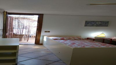 Photo for Four-room apartment with a flowered garden in Baia de Bahas