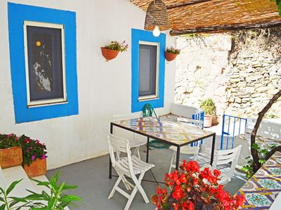 Photo for Very cute seaside Aeolian style house 10 mt from the sea in San Gregorio bay