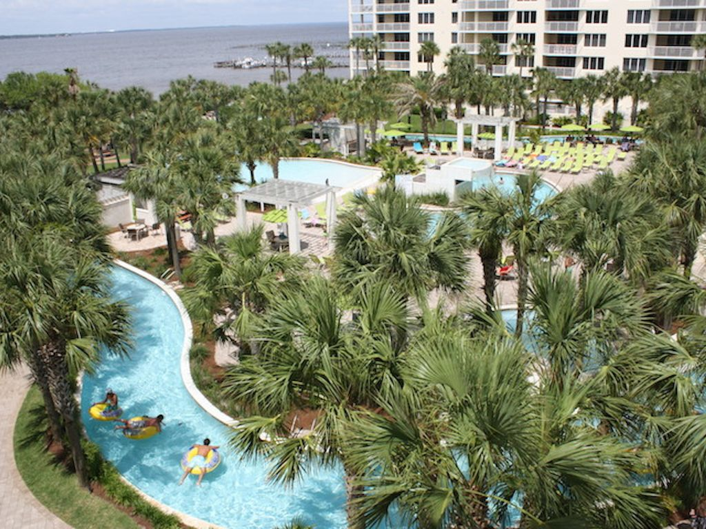 The View From Your Balcony Overlooking Lazy River Pools And Bay