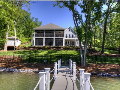 Photo for Expansive new custom NC lake front home with pool & dock