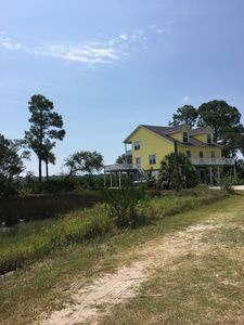 Photo for house with beautiful marsh and ocean view with wifi and golf cart included on