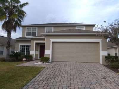 Photo for 5 Bed, 3 Bath executive home on secure gated community, 15 mins from Disney