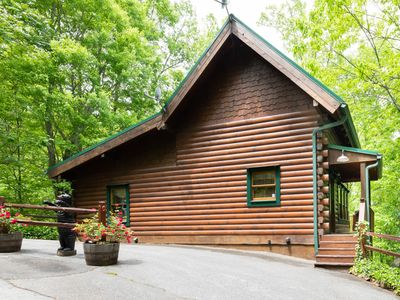 Photo for Charming cabin with wrap-around porch, pool access, and hot tub