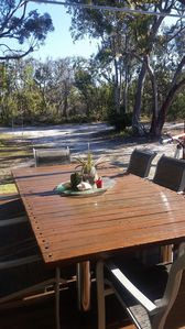 View of the outdoor deck and surrounding bushland.
